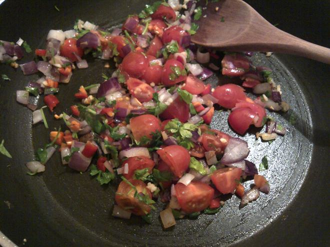 frying tomatoes, parsley, onion and garlic